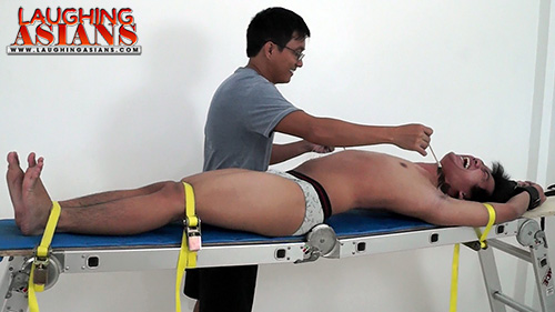 Asian boy tied and tickled